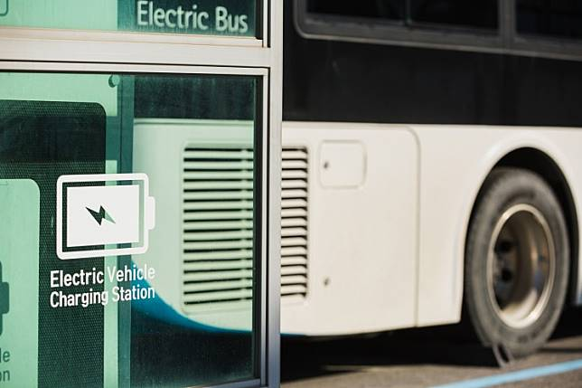 An electric bus at a charging station.