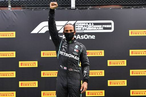 Winner Mercedes' British driver Lewis Hamilton celebrates on the podium after the Formula One Styrian Grand Prix race on July 12, 2020 in Spielberg, Austria.