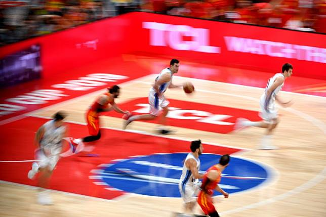 Argentina's Luis Scola (center) runs with the ball during the Basketball World Cup final game between Argentina and Spain in Beijing on September 15, 2019.
