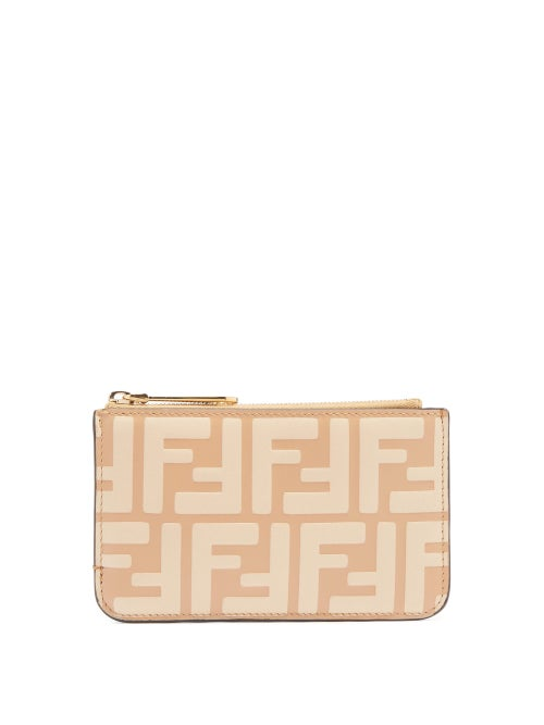 Fendi - Fendi's beige purse is hallmarked with a tonal iteration of the label's distinctive FF logo, which was designed by Karl Lagerfeld in 1965. Crafted in Italy from smooth leather, it has a zipped coin compartment and is fitted with four back card slots. Ensure your essentials are kept close to hand by using the lobster clasp to attach it to your everyday bag.