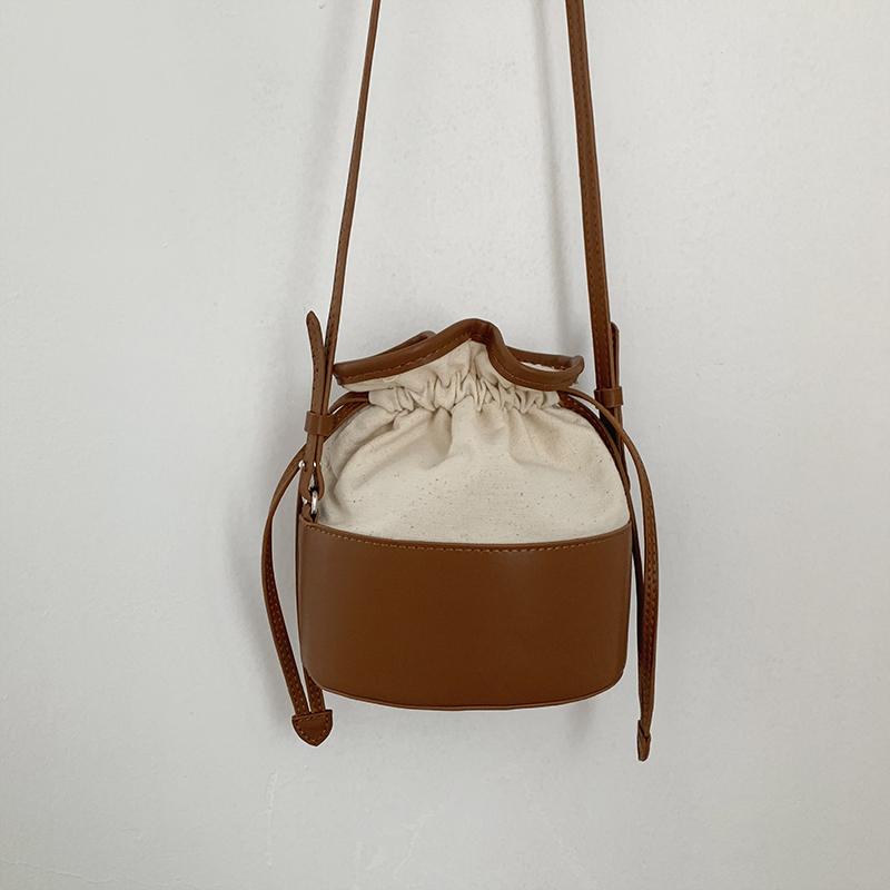 韓國夏季新款PU拼接帆布抽繩小水桶包ins女包百搭可愛單肩斜跨包
