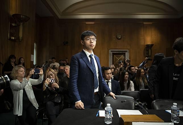 Joshua Wong arrives to speak on Capitol Hill on Sept. 17. Photographer: Al Drago/Bloomberg