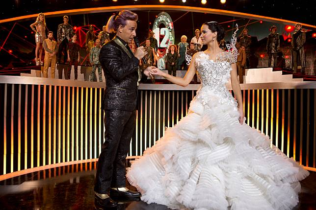 HUNGER GAMES, THE: CATCHING FIRE (2013) - STANLEY TUCCI - JENNIFER LAWRENCE.