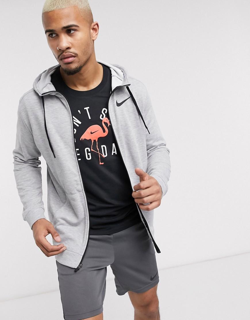 Sweatshirt by Nike The original cosy layer Drawstring hood Zip placket Nike Swoosh logo Side pockets