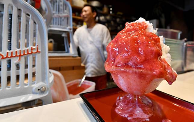 This picture taken on June 21, 2019 shows a kakigori dessert prepared by shop owner Koji Morinishi using natural ice in the Yanaka district of Tokyo.