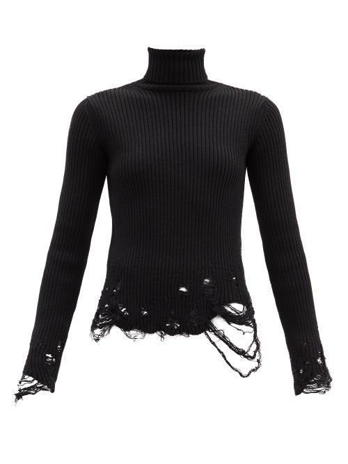 Balenciaga - Balenciaga puts a deconstructed spin on classic knitwear with this black roll-neck swea