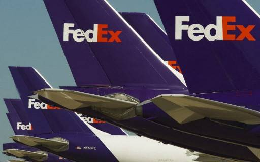 Federal Express cargo jets are lined up at the Memphis, Tennessee, headquarters World Hub, where aircraft wait to be loaded with packages and documents. A FedEx pilot was arrested in China and released on bail, the company said September 19, 2019, amid an ongoing row with Beijing over the US firm's delivery irregularities involving telecoms giant Huawei. Todd Hohn, a former US Air Force pilot, was arrested by Chinese authorities a week ago as he waited for a commercial flight in the company's Asia hub of Guangzhou, after making a round of deliveries.