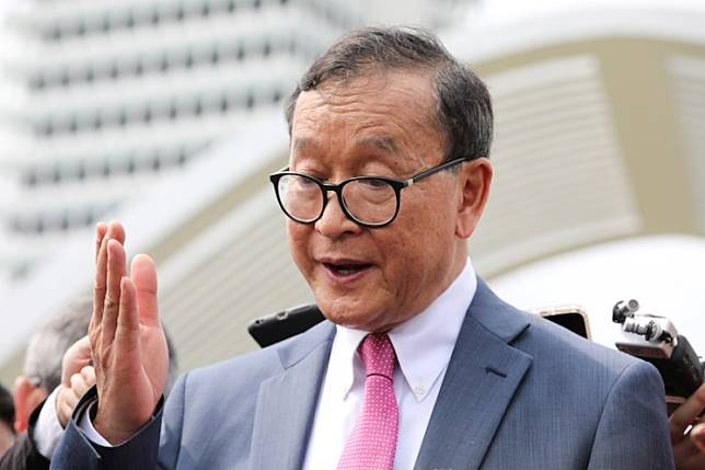 Self-exiled Cambodian opposition party founder Sam Rainsy speaks to members of media after a visit to Parliament House in Kuala Lumpur, Malaysia, November 12, 2019.