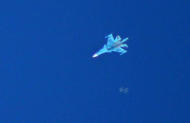 A Russian Sukhoi Su-34 fighter drops bombs over the Syrian village of Kafr Ain in the southern countryside of Idlib province on September 7, 2018. The presidents of Iran, Russia and Turkey were due to meet today in Tehran for a summit set to decide the future of Idlib province amid fears of a humanitarian disaster in Syria's last major rebel bastion.