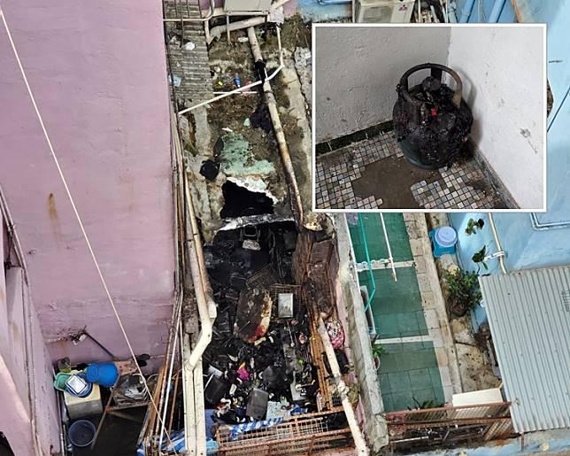火警後涉事單位燒通頂,穿了一個大洞,屋內滿布雜物,全部被燒毀。 梁國峰攝