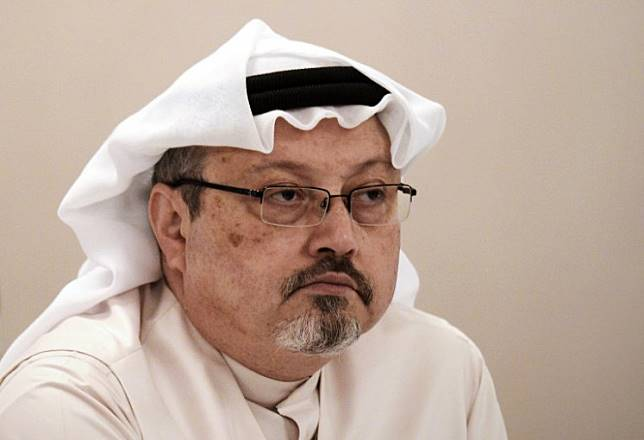 In this file photo taken on December 15, 2014 , Saudi journalist Jamal Khashoggi attends a press conference in the Bahraini capital Manama. Saudi Arabia's attorney general sought the death penalty for five of 11 defendants charged with the murder of Khashoggi as their high-profile trial opened in Riyadh on January 3, 2019.