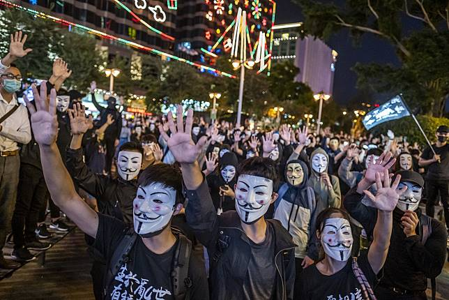 Demonstrators wear anonymous masks, also known as Guy Fawkes masks, during a protest on Nov. 5. Photographer: Justin Chin/Bloomberg