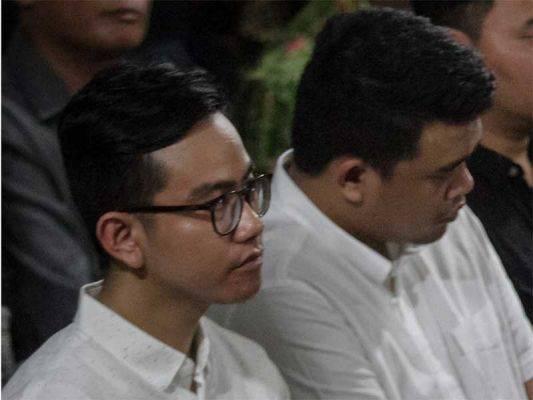 Gibran Rakabuming Raka (kiri) dan Bobby Nasution.