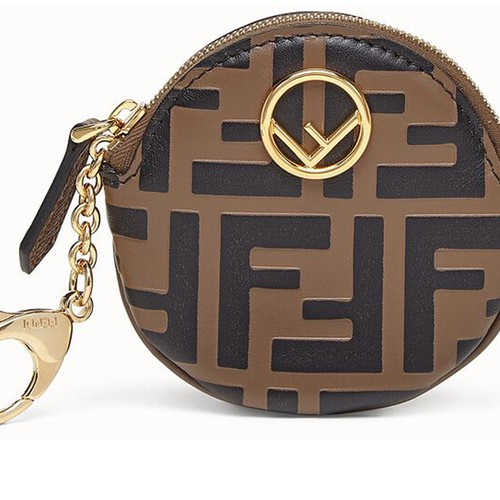 Round coin purse with clip and zip fastening. Made of brown leather. Embellished with embossed FF motif print and painted black. Branded with the F is Fendi logo. Gold-finish metalware. Made in Italy