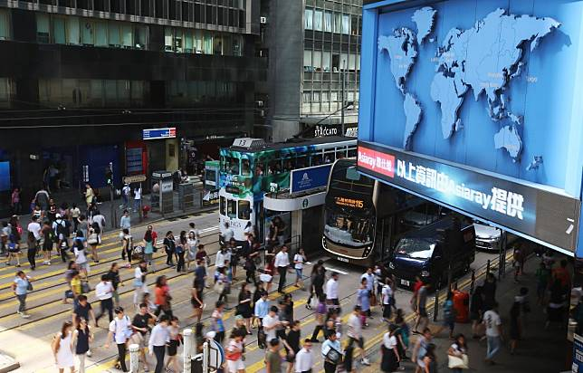 What are the chances of companies implementing a four-day working week in Hong Kong where long hours are a way of life?