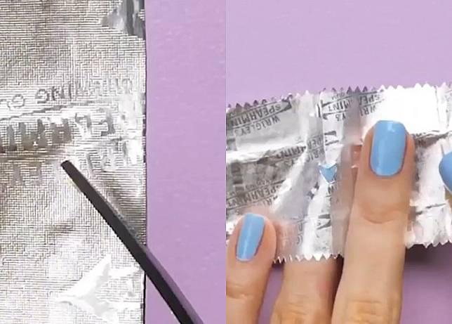 Step 2:用鉸剪剪出心形窿窿後,將銀色包裝紙放於指甲面上。(互聯網)