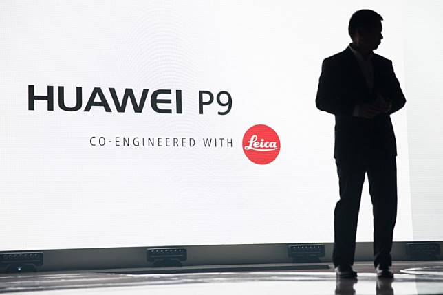 CEO of Consumer Business Group of Chinese tech company Huawei, Richard Yu, addresses the audience to launch the Huawei P9 smartphone during a press conference at Battersea Evolution in London on April 6, 2016. The P9 was created in partnership with German camera manufacturer Leica and houses a dual camera system. JACK TAYLOR