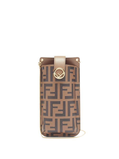Fendi - Printed in the hallmark FF logo - designed in five seconds by Karl Lagerfeld in 1965 - Fendi's brown and black phone pouch will bring a statement finish to daily edits. It's made in Italy from leather with a card slot on the back and secures with an F-logo plaque push-studded flap. Use the detachable gold chain strap to carry it over a blouse and coordinating-print skirt for a maximalist effect.