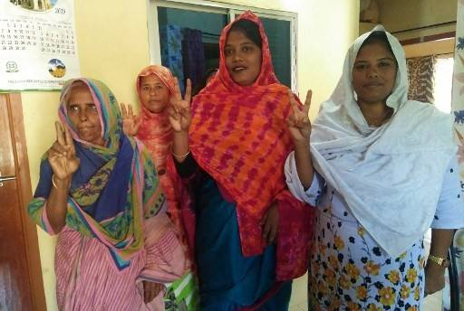In this photo taken on October 14, 2019, Pinki Khatun (second, right), the first transgender candidate elected in Bangladesh, poses with local women in Kotchandpur. A transgender candidate has been elected as councillor for a rural Bangladeshi town, the first in the ultra-conservative Muslim-majority nation where laws still discriminate against sexual minorities.