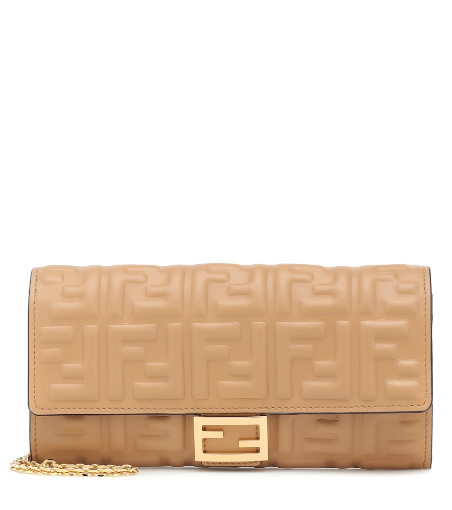 The Baguette leather wallet from Fendi makes a sleek impression with its FF-embossed beige leather.