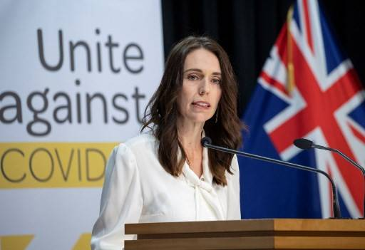 In this file photo taken on April 20, 2020 New Zealand Prime Minister Jacinda Ardern speaks at a post-Cabinet media conference at Parliament House in Wellington.Ardern said on Wednesday she could lift all social distancing measures to return the country to normal life, bar the international border closure, as early as next week.