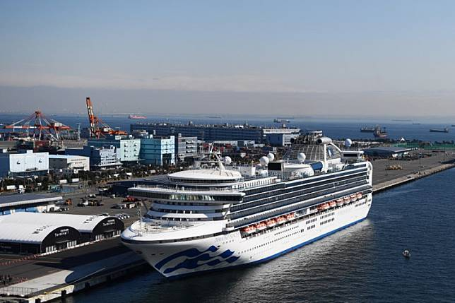 The Diamond Princess cruise ship, with around 3,600 people quarantined onboard due to fears of the new coronavirus, is seen anchored at the Daikoku Pier Cruise Terminal in Yokohama port on February 10, 2020. - Six more people on a cruise ship off Japan are found to have the new coronavirus, the government said February 9, bringing the number who have tested positive on board to 70.