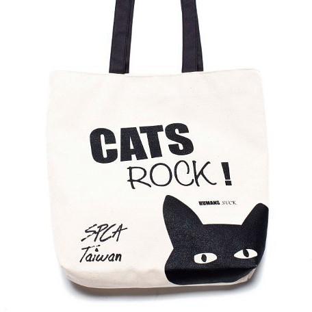 品牌:SPCA 材質:帆布 尺寸:35x34cm CATS ROCK, HUMANS SUCK! 可愛黑色貓咪,大容量厚帆布袋 袋口有磁釦設計,安全保護包包內的物品唷 帶上托特包出門不僅環保,也讓大家