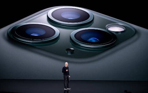 In this file photo taken on September 10, 2019 Apple CEO Tim Cook speaks on-stage during a product launch event at Apple's headquarters in Cupertino, California. Apple embarks on an epic court battle with the EU on Tuesday, fighting the commission's landmark order that the iPhone-maker reimburse Ireland 13 billion euros ($14 billion) in back taxes.