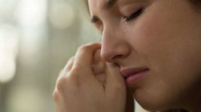 Ilustrasi seorang perempuan sedang menangis. (Shutterstock)
