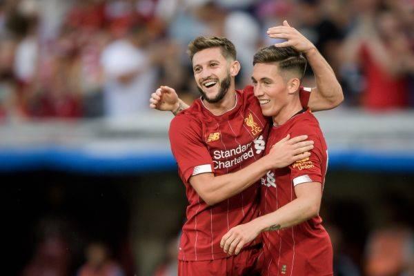 Harry Wilson (kanan) merayakan golnya ke gawang Lyon bersama Adam Lallana.