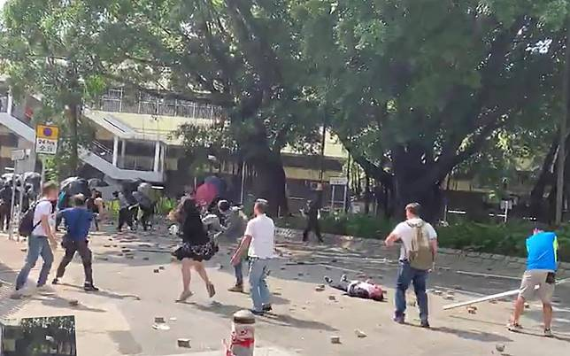 Elderly  man clings to life after being hit in head by brick thrown by Hong Kong protesters during clash with residents in Sheung Shui