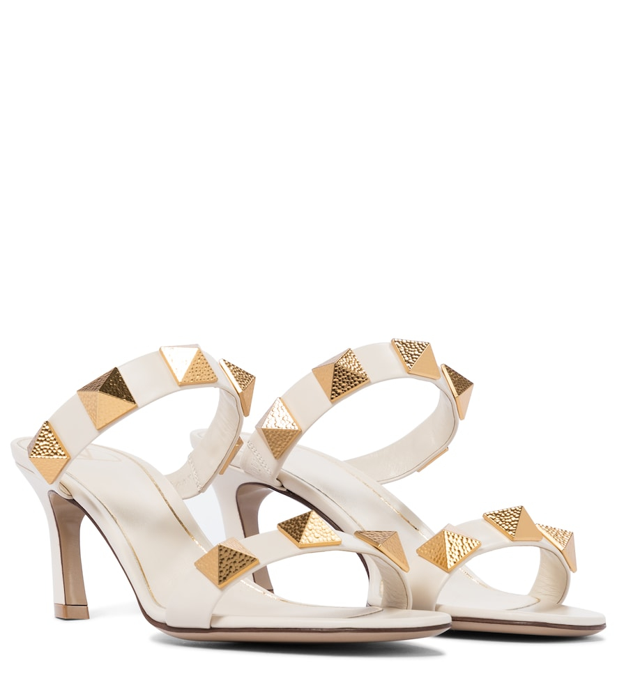 These white sandals from Valentino Garavani are embellished with the label's new Roman Studs, distin