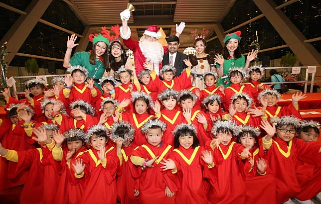 Hong Kong bankers from Morgan Stanley join pupils for carols at International Commerce Centre for Operation Santa Claus