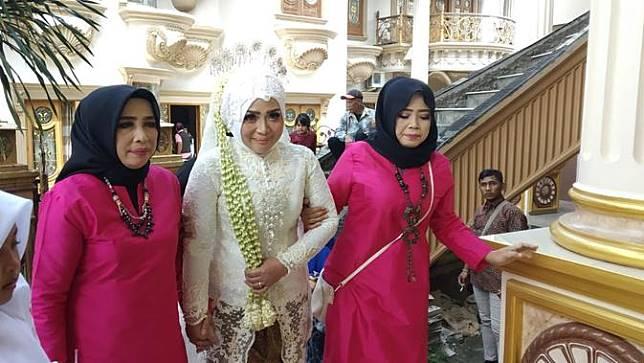 Pernikahan Muzdalifah dan Fadel Islami