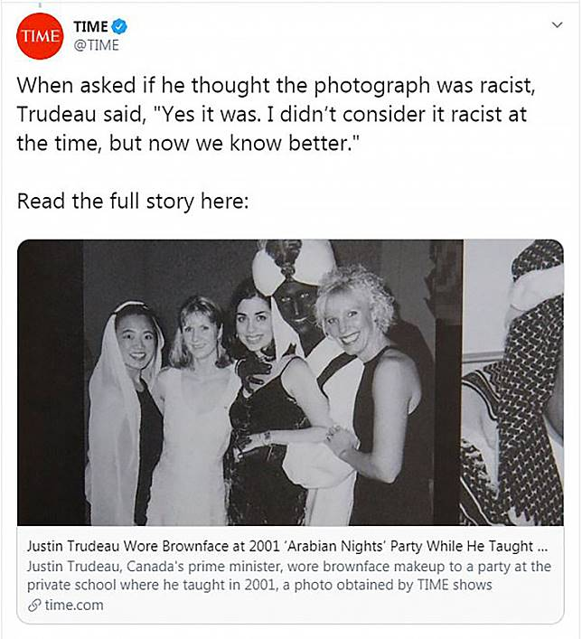This handout image obtained September 19, 2019, courtesy of Time magazine, off the Time Twitter feed shows Canada's Prime Minister Justin Trudeau wearing brown face at a party in 2001.