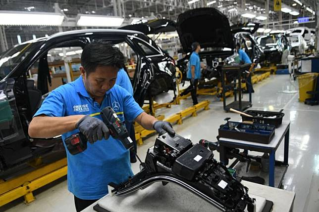 Workers assemble Mercedes-Benz New GLC cars in the carmaker's plant in Bogor, West Java, on Dec. 10, 2019.