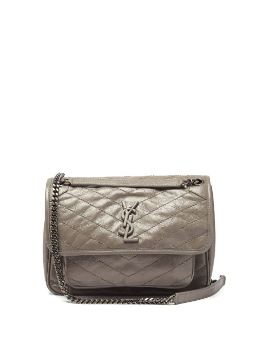 Saint Laurent - Saint Laurent's taupe-grey Niki shoulder bag is crafted from glossy chevron-quilted