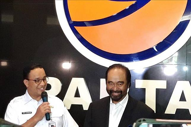 Jakarta Governor Anies Baswedan (left) and NasDem Party chairman Surya Paloh speak to reporters at the NasDem Party headquarters in Central Jakarta on Wednesday.