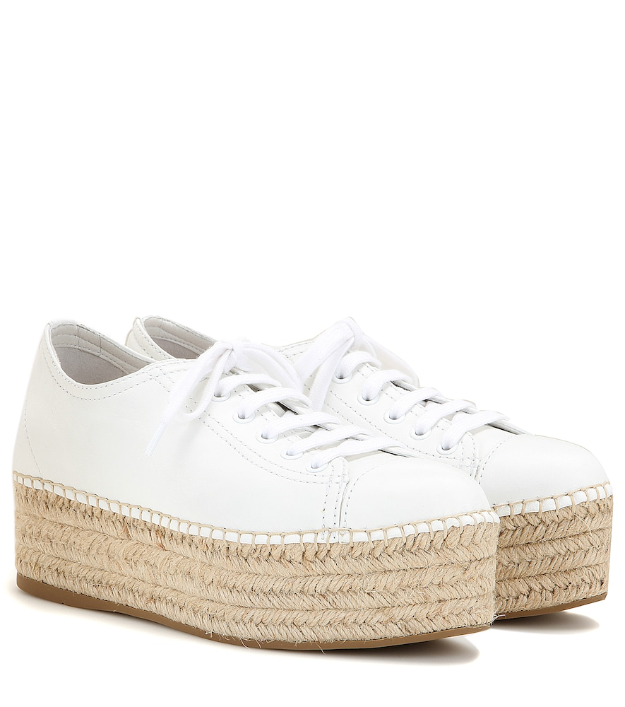 Refresh your look for the new season with Miu Miu's espadrille-style sneakers.