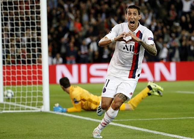 Paris Saint-Germain's Argentine midfielder Angel Di Maria celebrates scoring his team's first goal during the UEFA Champions league Group A football match between Paris Saint-Germain and Real Madrid, at the Parc des Princes stadium, in Paris, on September 18, 2019.