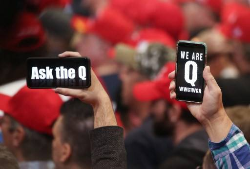 Supporters of President Donald Trump hold up their phones with messages referring to the QAnon conspiracy theory at a campaign rally at Las Vegas Convention Center on Feb. 21, 2020 in Las Vegas, Nevada.