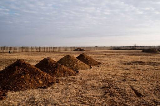 A photograph taken on July 9, 2020 shows mounds of soil where graves are dug at the Honingnestkrans cemetery, in Pretoria, for victims of the COVID-19.Long after the funding for his project was frozen, Bilal Endris has kept a lonely watch over cemeteries in Ethiopia's capital by slipping cash to gravediggers to alert his team to any sudden spikes in burials.  In a nation where fewer than 2% of deaths are registered, an increase in burials may be one of the first signs that a killer disease is on the loose.