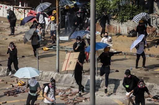 รัฐบาลจีนมีสิทธิ์ในการระงับใช้กฎหมายของฮ่องกง หากฮ่องกงอยู่ในภาวะสงคราม หรือ วุ่นวาย DALE DE LA REY / AFP