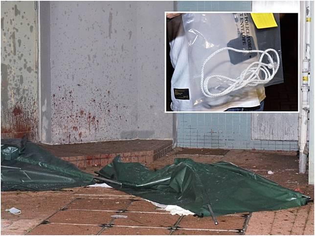 警方發現女死者頸部有勒痕,疑先遭人扼殺,再被丈夫抱起雙雙墮斃。
