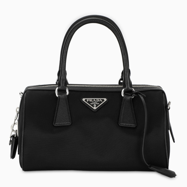Top handle bag by Prada in black nylon and leather. Double top handle, detachable shoulder strap wit