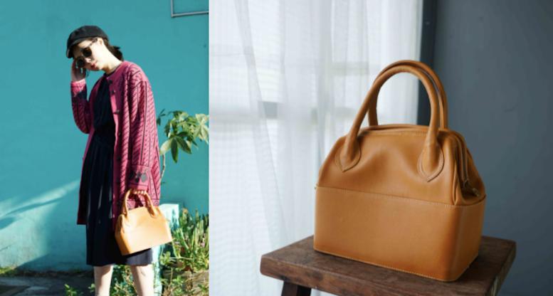義大利製橘色皮革硬殼梯形手提包