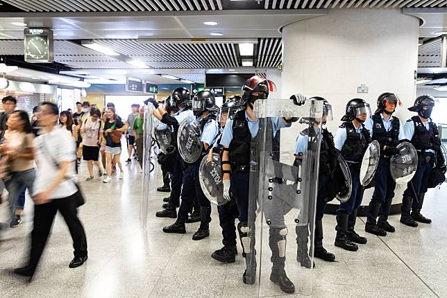 Riot police stand guard inside Admiralty Station, Sept. 8. Photographer: Kyle Lam/Bloomberg