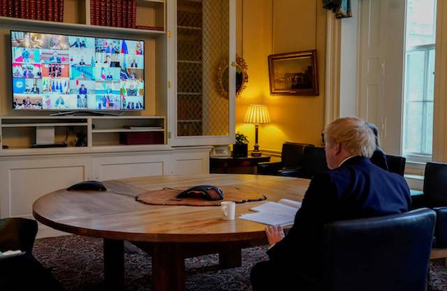 Britain's Prime Minister Boris Johnson sits in the study of 10 Downing Street, on a video conference call to other G20 leaders during the coronavirus outbreak in London, Britain on Thursday