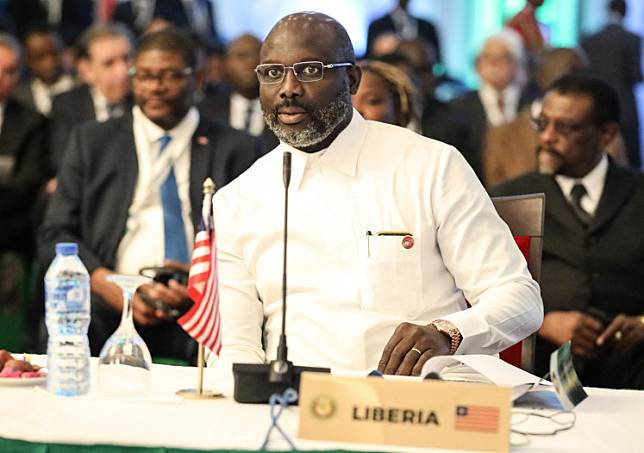 Liberian President, George Weah attends the 56th ordinary session of the Economic Community of West African States in Abuja on December 21, 2019.