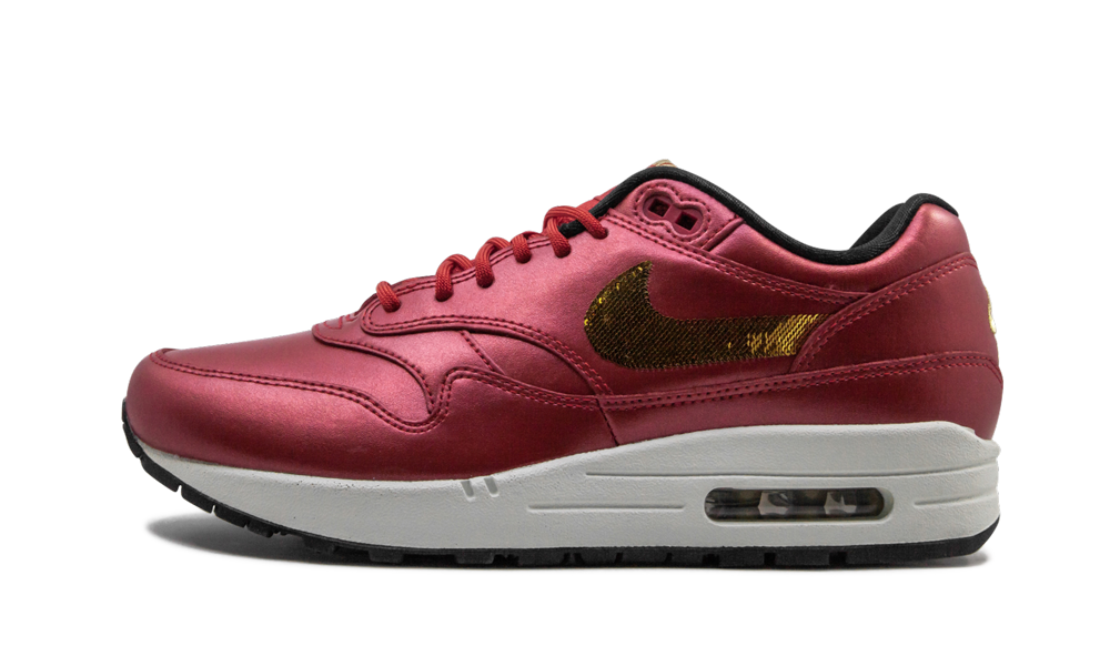 The Nike Air Max 1 Women's lifestyle sneaker, with its vibrant hue and glamourous detailing, instant